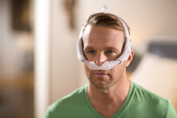 Man Wearing Philips DreamWear CPAP Mask