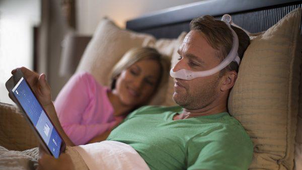 Man sleeping with Philips Dreamwear CPAP Mask